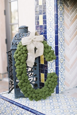 wedding monogram made with greenery and rustic burlap