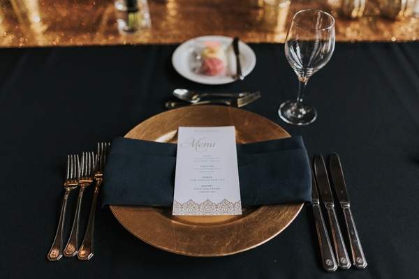 wedding tablescape, black linens, gold charger, white menu with gold details