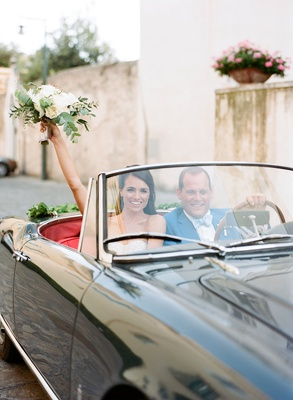 Wedding getaway car bride and groom in vintage convertible grey black red interior italy
