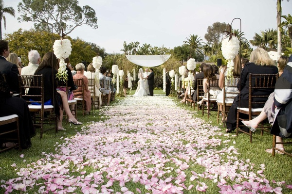 Pink ombré outdoor wedding ceremony aisle