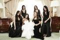 Bride with bridesmaids in bridal suite