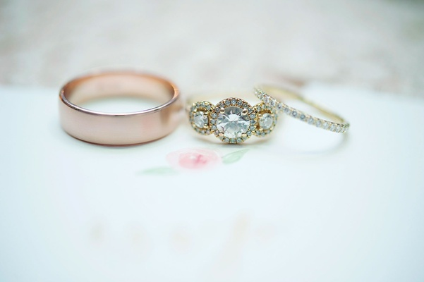 Wedding ring rose gold men's band and pave yellow gold women's band with three stone engagement ring