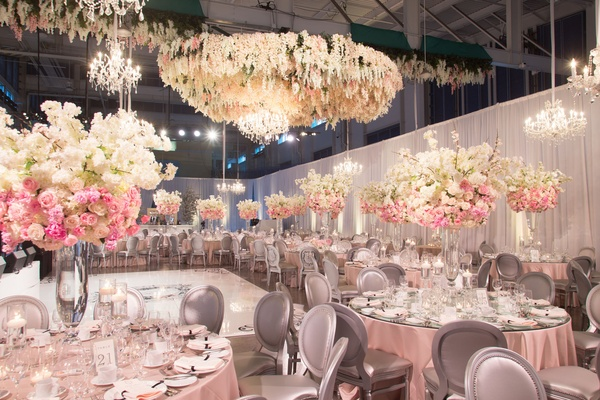 Wedding reception same sex wedding pink linen tall centerpiece arrangements flower chandelier