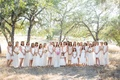 Mismatched bridesmaid dresses in shades of white cream