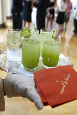 Lime green iced beverages with cucumber garnish