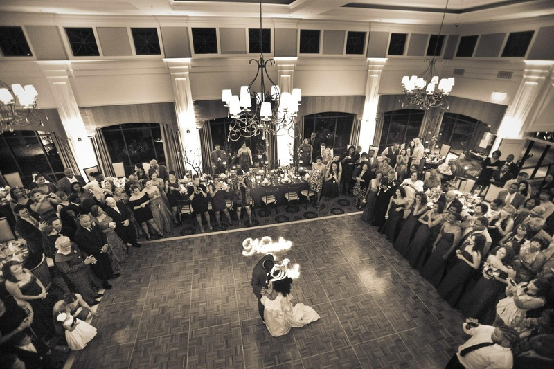 Black and white photo of couple's first dance in ballroom