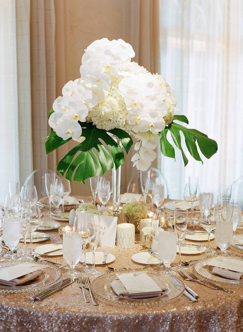 Reception décor photos gold sequin linen with tropical