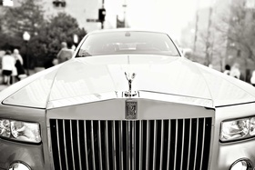 Black and white photo of Rolls-Royce wedding car from wedding ceremony to reception location