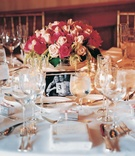 White linens and pink floral centerpiece