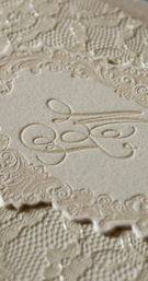 Lovely letterpress adds a subtle texture on top of this lace folder.