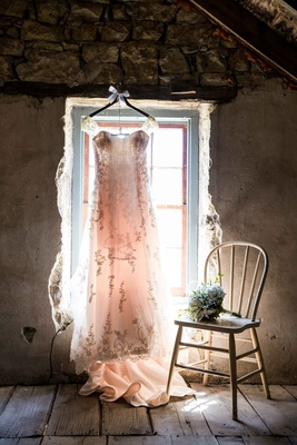 Wedding dress in rustic window with embroidery and lace straps