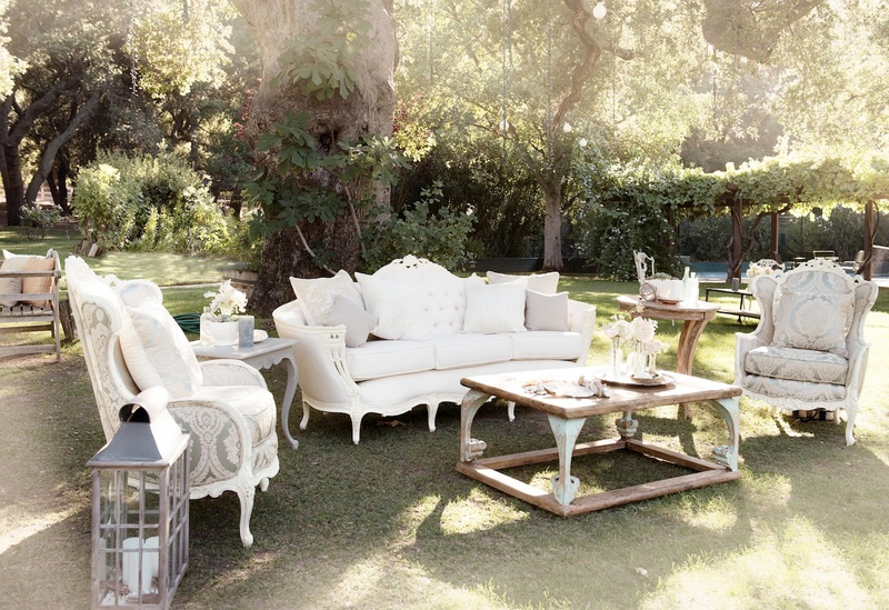 Antique furniture on grass lawn of Katrina Hodgson's wedding reception