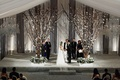 Indoor Chicago wedding with tree branch ceremony structure