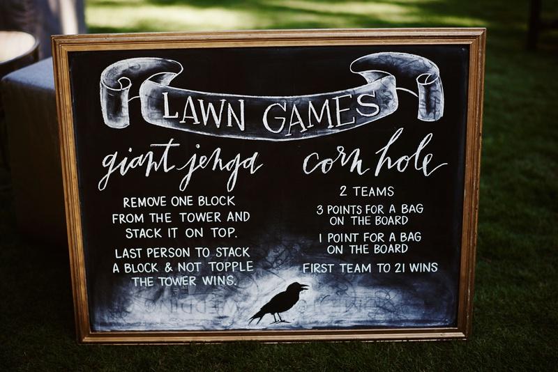 halloween wedding reception lawn games giant jenga corn hole chalkboard sign raven crow