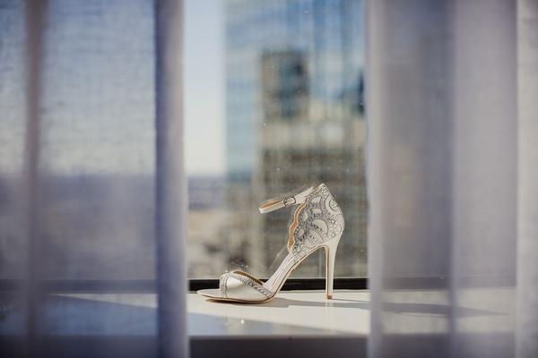 Wedding shoe in window sill curtain peep toe style ankle strap metallic details silver