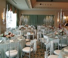 Tables with blue-green linens and antique candleholders
