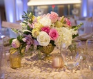 Wedding reception table, textured tablecloth, gilded urn with pink & white roses, hydrangeas, orchid