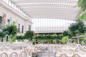 wedding reception cleveland museum of art tall ceiling glass skylight tropical centerpiece monstera