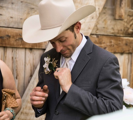 Grey suit jacket with white cowboy hat and rustic boutonniere