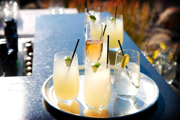 Margaritas in glasses with lime garnish and champagne