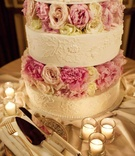 White wedding cake with flower motif and peony rose layers