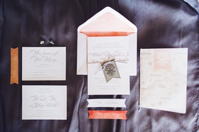 white invitation suite with peach accents