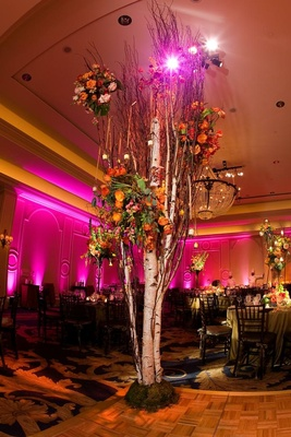 Tall tree with candles and flowers on dance floor