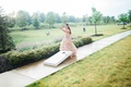 bride in blush vera wang gown plays cornhole