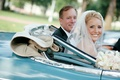 bride and father ride in blue vintage mercedes car