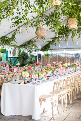 tented rehearsal dinner with bistro lights above the tables