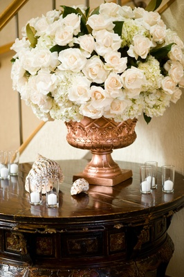 Wedding reception copper urn with seashells