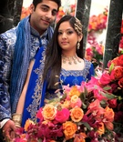 Indian bride and groom in royal blue attire