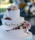 four layer wedding cake with blue bottom layer when ya know ya know gold writing fresh flowers
