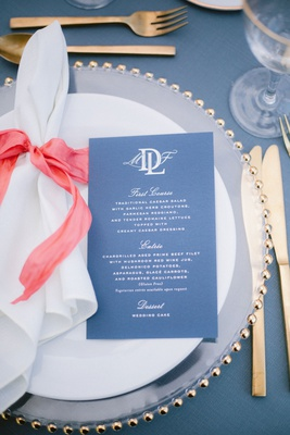 wedding reception place setting blue white menu crest with courses napkin pink coral ribbon