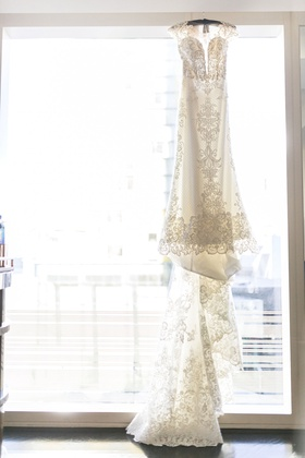 cristiano lucci wedding dress with lace details cap sleeves and long train
