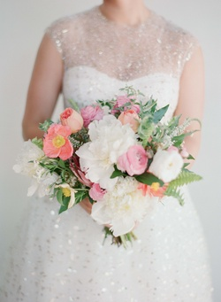 Bride in sparkle gold dress holding pink and white bouquet