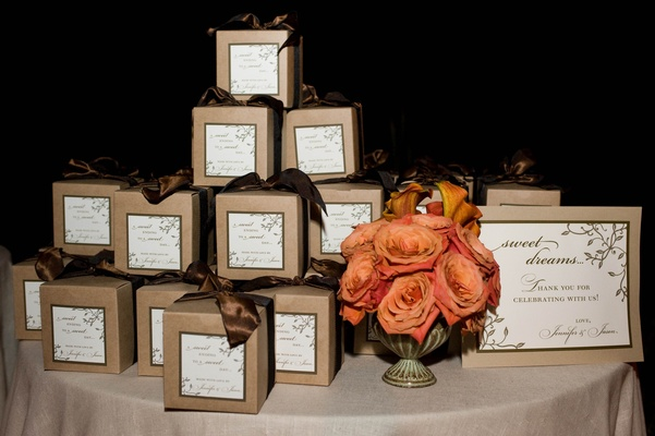 Wedding favor display table with brown boxes