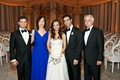 Bride and groom with blue mother of groom dress