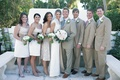 Beach wedding bride and groom with wedding party in natural colors