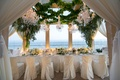 Wedding vow renewal dinner intimate setting one long rectangular table flower arrangements low