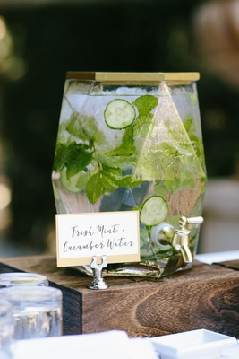 wedding ceremony beverage geometric drink dispenser gold top cucumber fresh mint water infused