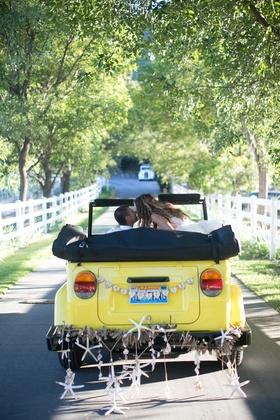 Katrina Hodgson and Brian drive away in VW Thing with seashells