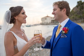 couple toast champagne at beach wedding