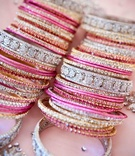 Pink, silver, and gold crystal-studded bracelets