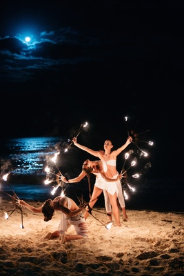 Female fire dancers at a night beach wedding reception, Playa del Carme, Mexico