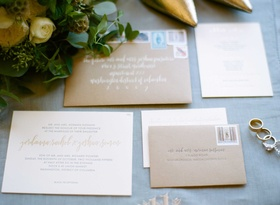 Wedding invitation white with gold details and kraft paper envelopes calligraphy stamps