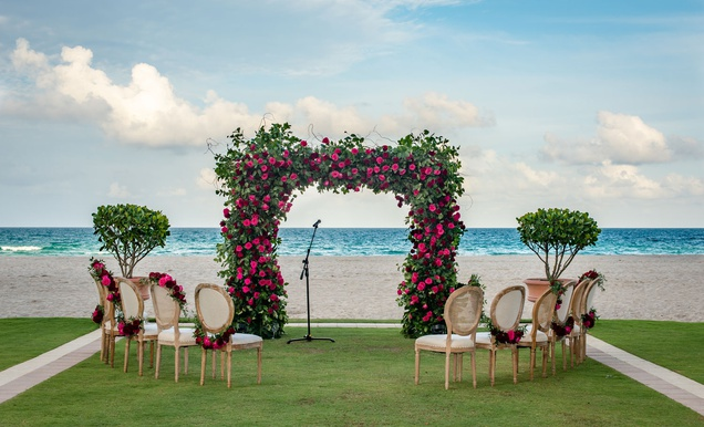 Intimate Oceanfront Wedding with Romantic Red, Pink & White Palette
