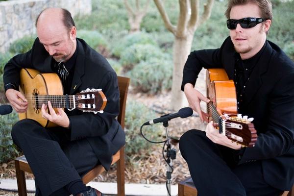 two men playing Spanish guitar