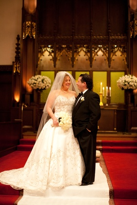 Bride and groom on aisle runner at church