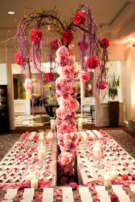 Pink rose tree trunk with purple branches on escort card table